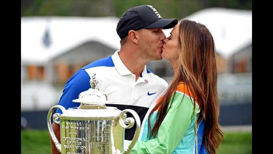 Golfer Brooks Koepka Romantic blow. Golfer Brooks Koepka appears to his   girlfriend's good-luck kiss.