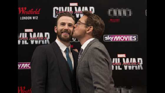 "Iron Man kisses Captain America! Iron Man celebrates Captain America: Wishing ""American Buttocks"" Happy Birthday."