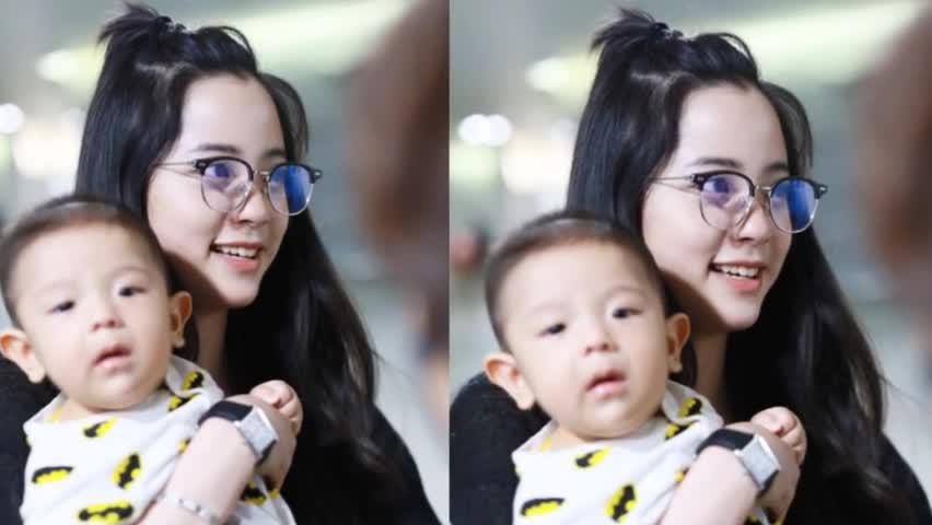 Ouyang Na showed up at the airport with a little boy in her arms. She smiled dimples with half-rimmed glasses and was very grounded.