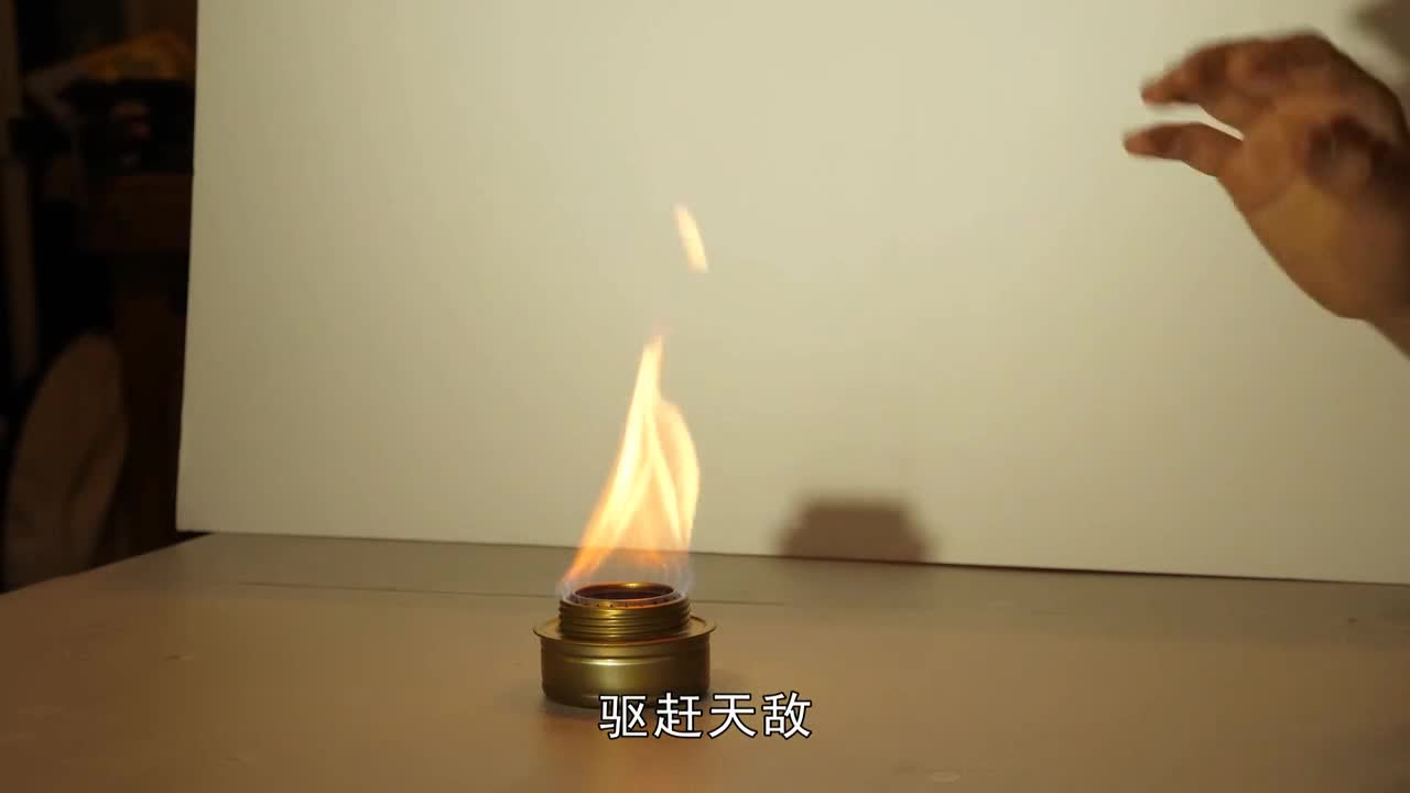 Have you ever seen a black flame? Approaching alcohol with saline water, this picture is magical like a movie special effect.