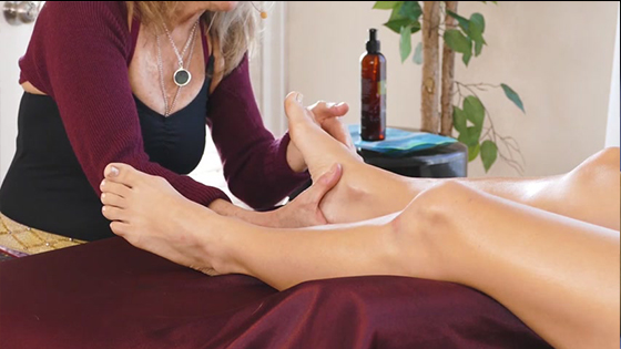 Essential oil massage to relax leg muscles -  Feet and Legs Massage Therapy
